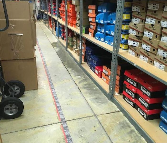 Shoe store with stock and water damage on floor