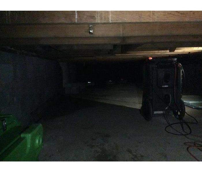 Crawlspace with SERVPRO equipment running