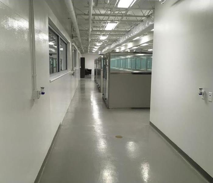 Office walkway with concrete floors and cubicles