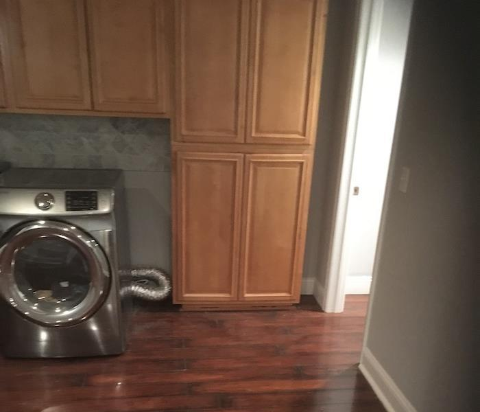 Laundry room with water on the floor