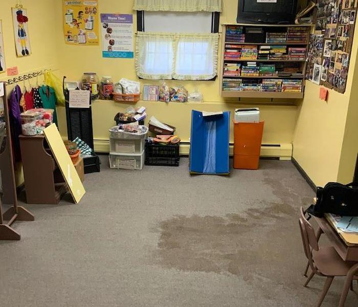 Children's daycare room with wet carpet