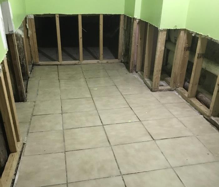 Tile floor in a room with flood cuts on sheetrock