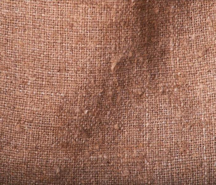 burlap textile fire damaged