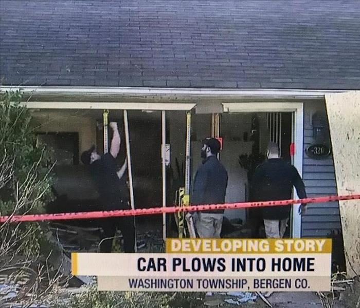 Building Services Car Crashes Through Home
