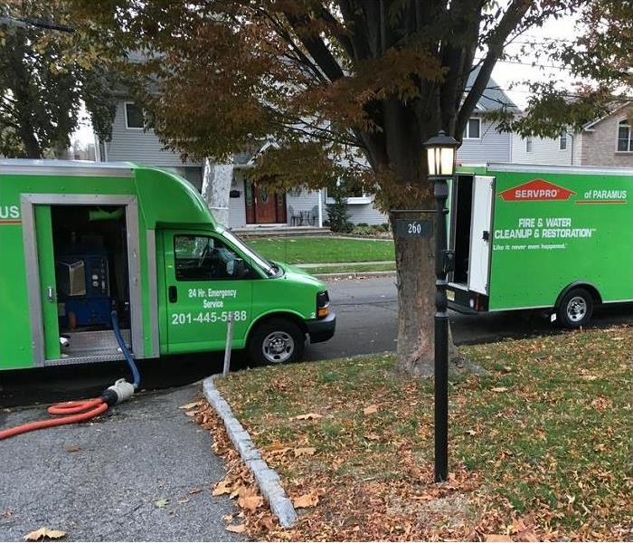 SERVPRO restoration vehicles in front of home