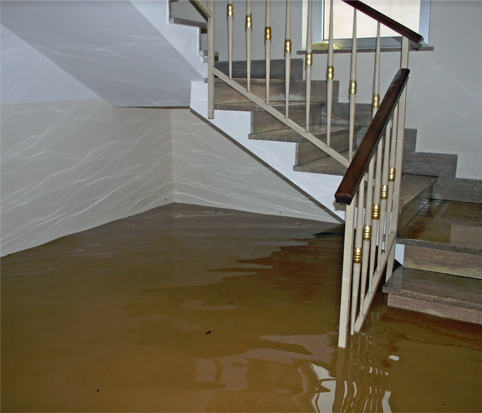 a flooded room with stairs