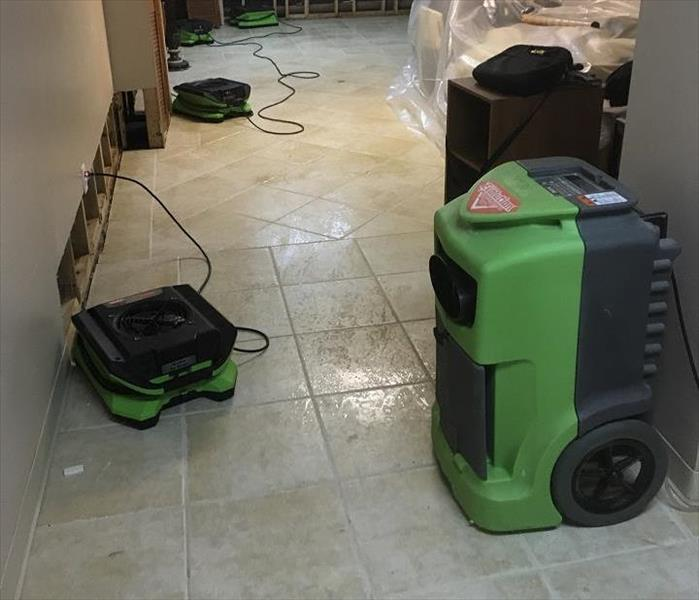 SERVPRO drying equipment in large, water damaged room
